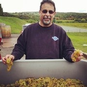 Barry Tortolon winemaker with chardonnay